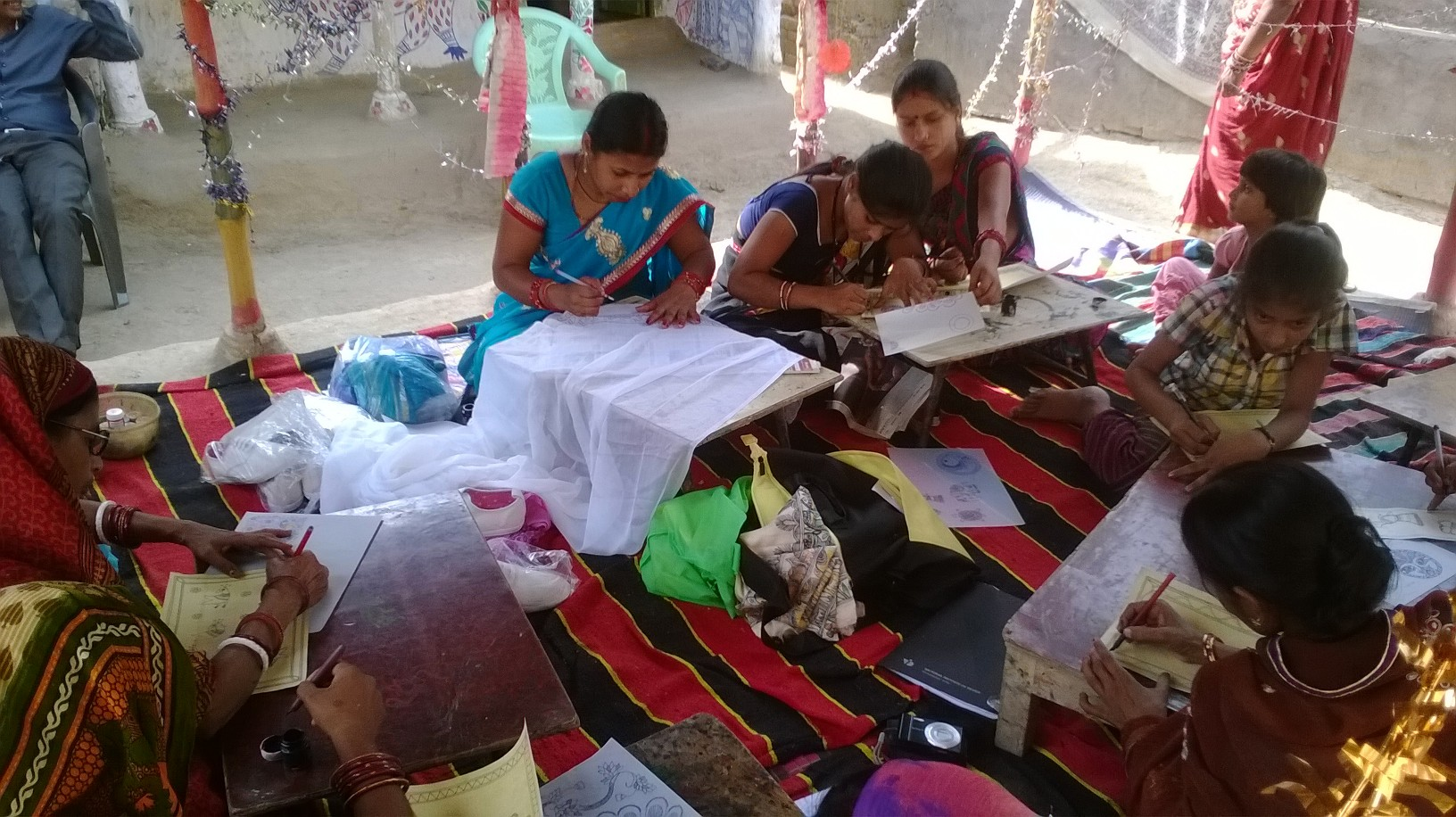 women at work in madhubani
